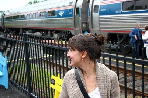 woman posing outside the Amtrak