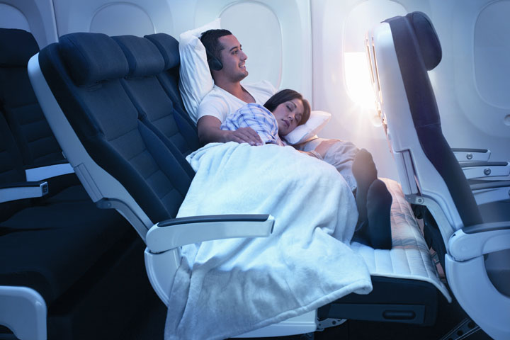 sky-couch-man-sitting-with-woman-laying-down(3)